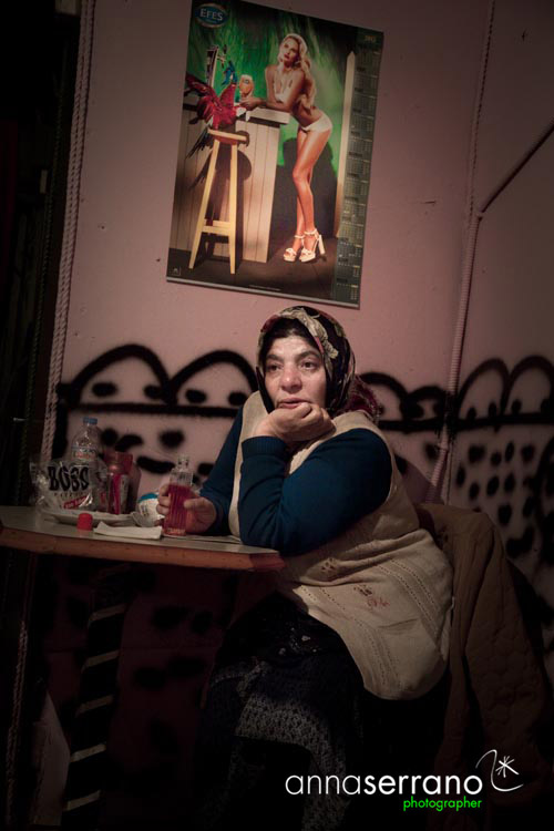 Lady at the toilette's door in a Tarlabasi night club, Istanbul