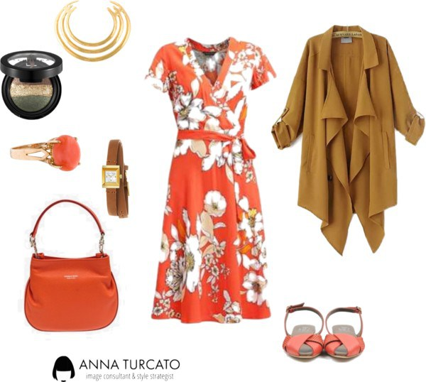 The orange dress di annaturcato contenente statement rings