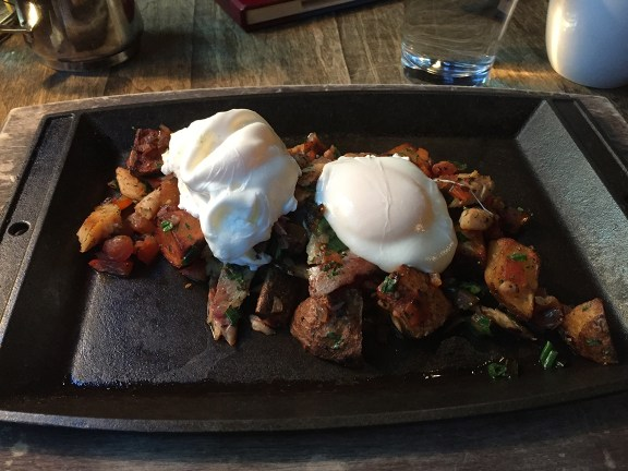 Smoked Trout Hash with poached eggs, from the Foundry Grill.