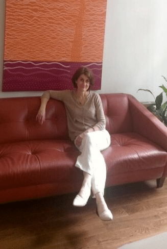 Ann Cecil-Sterman on couch. Advanced Acupuncture