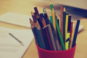 colored pencils in red cup