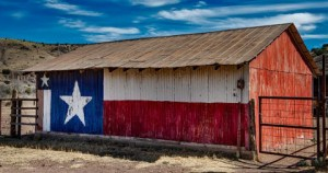 Old barn with the Texas state flag painted on the side.