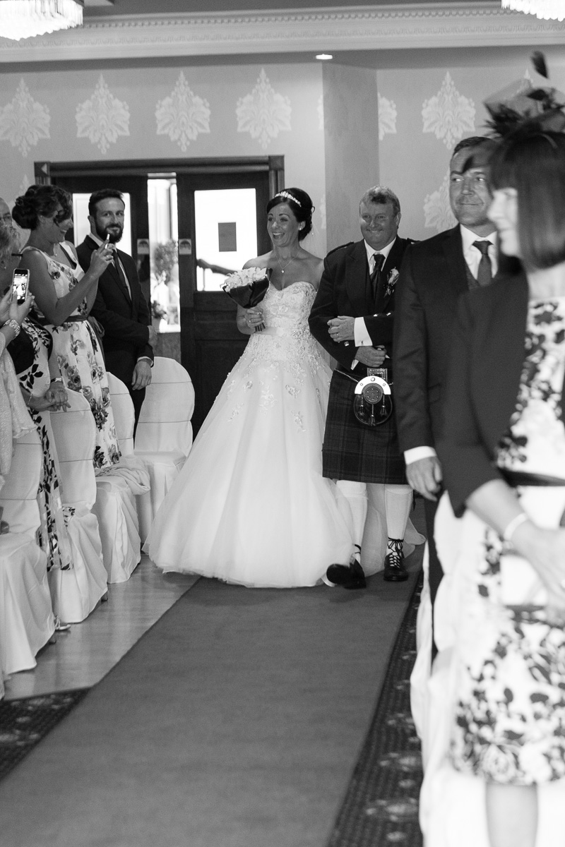 Bride walking down the aisle at the Woodlands Hotel, Dundee