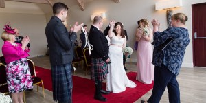 Bride, Groom and guests celebrating at Forbes of Kingennie
