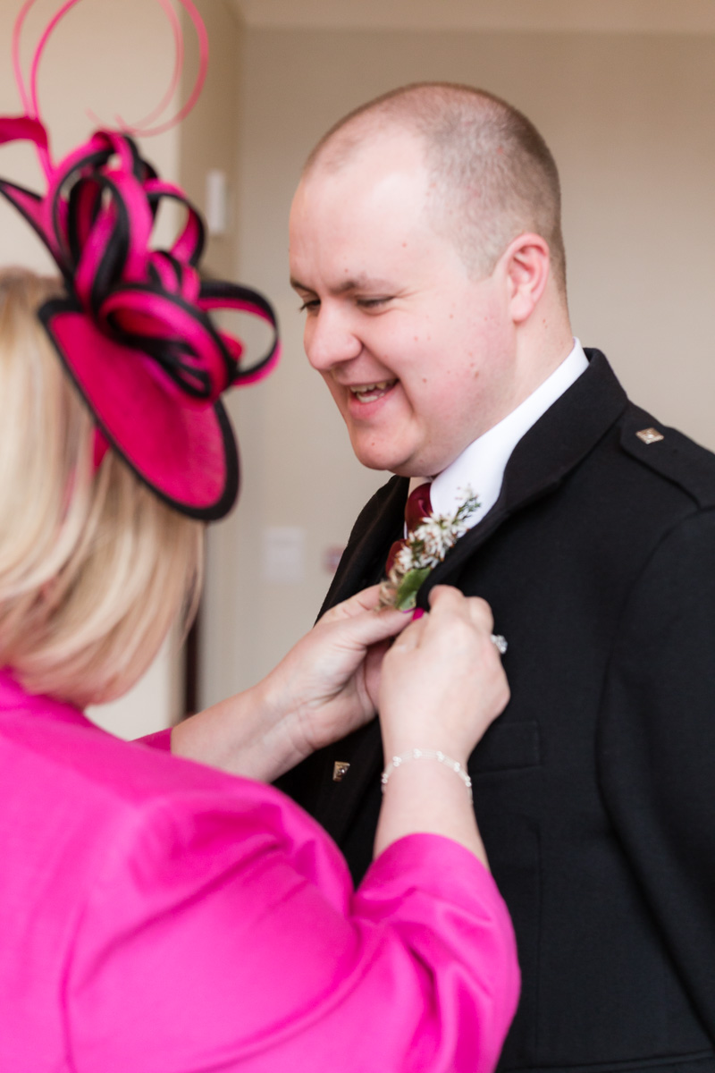 Mother of the Groom fixing buttonhole