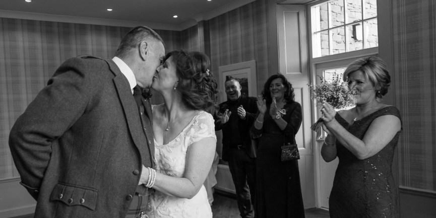 Bride and Groom kissing at Glen Clova Hotel