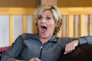 Bridesmaid laughing at Glen Clova Hotel