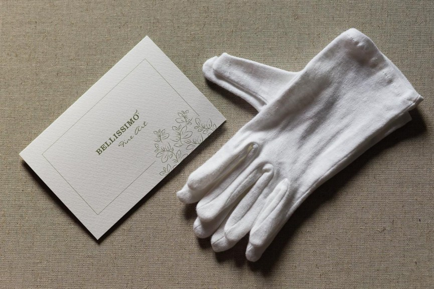 Fine art wedding album box and white gloves