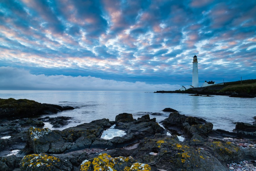 Dramatic skies over Scurdie Ness Lighthouse at sunrise