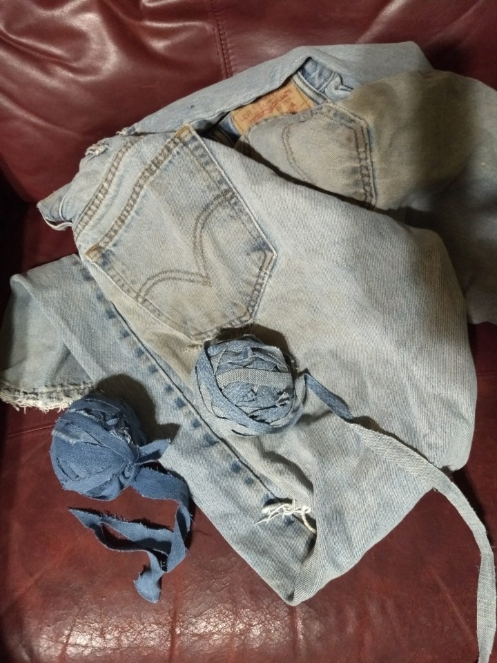 Image of old jeans and finished farn from tutorial on how to make fabric yarn,