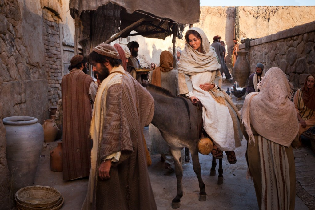 Mary and Joseph enter Bethlehem and begin searching for an inn