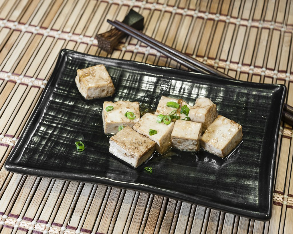 Prepared tofu dish with scallions.