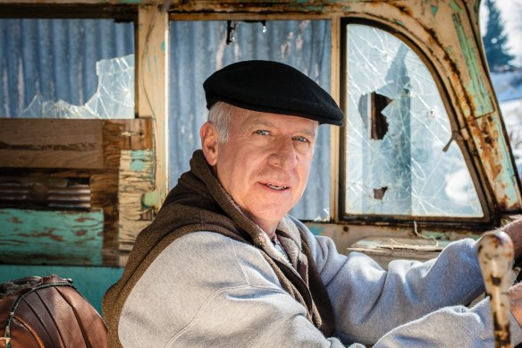 Portrait of man in an old smashed up bus