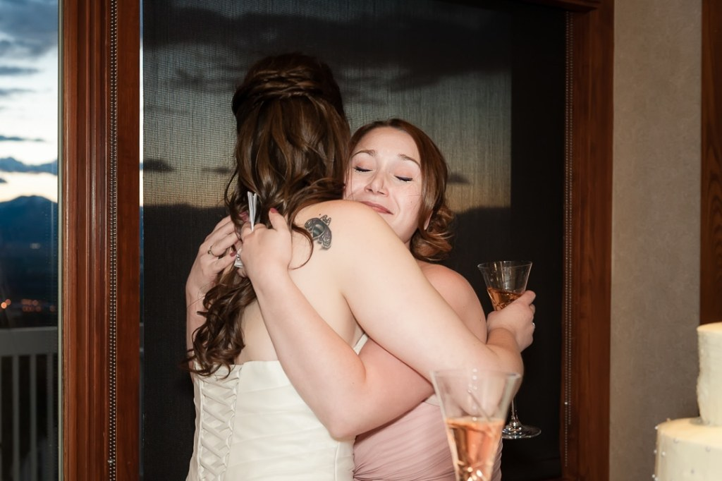 Nothing beats a hug from your best friend at your wedding following an amazing toast of cheer!