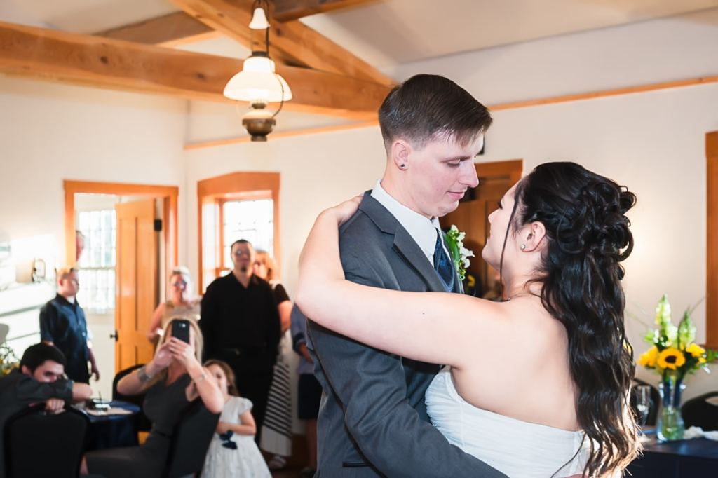 A young newly married couple dance together for the first time after their wedding.