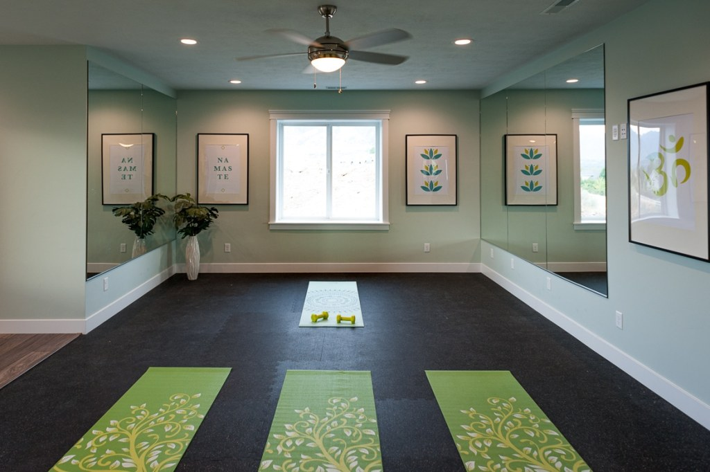 A calming workout room complete with yoga mats may be the perfect space to decompress before your wedding night and relieve insomnia.