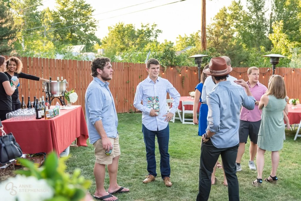 Wedding tour guests assemble at a friend's house in Boulder, Colorado for a back yard party.