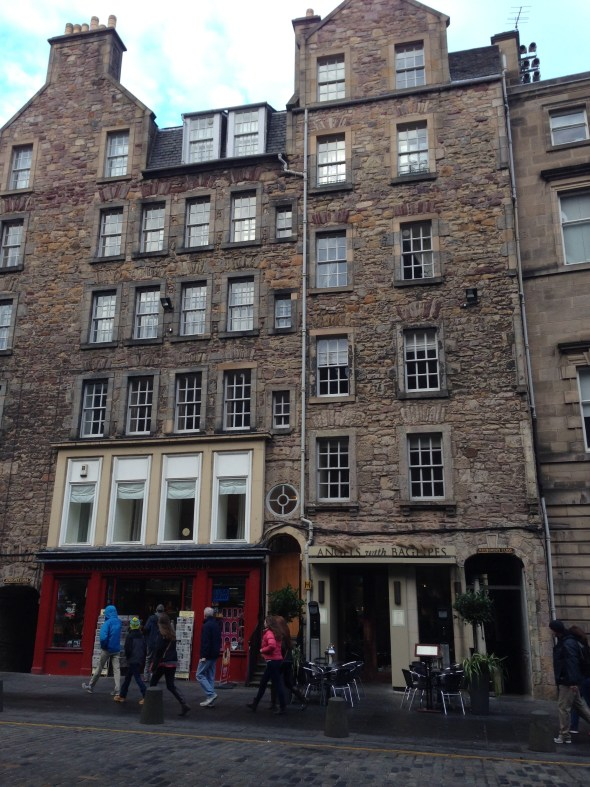 """Over the centuries, the buildings have remained, and the businesses have snuggled inside.  Remodeling (or """"re-furbishing"""", as they term it) works around the stone structures. The roads can't be widened, obviously, so traffic is very difficult."""