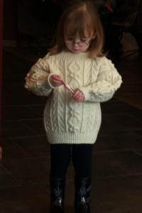 Aran, designed and knit by Cheryl Scallon for Level III of the TKGA Master Handknitting program.  That sweater is so pretty that it (almost) isn't upstaged by the charming child!