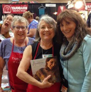Left to right: Some of the Yarn Barn of Kansas team: Mary Margaret (photo-bomb!), Dianne, Susan - with Anne