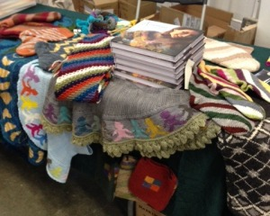 "Setting up the author's table at Rhinebeck.  Within hours, every book Merritt Bookstore had ordered was sold, and the table wasn't organized anymore!  But knitter's loved checking out the projects from ""Annetarsia Knits"""