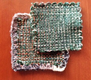 This is doubled sock yarn - one solid dark green, and the other is varigated.  I did a double-crochet edging on the bottom one, using a single strand of the varigated yarn.