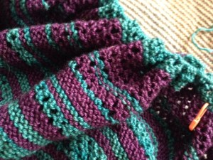 "I was too lazy to switch needles, so the stitches are all crammed onto the same 24"" needle that I started with.  There are supposed to be 387 sts, but I added a bunch of rows so I know there are many more.  They are too crowded to count, and I don't want to know, anyway.  I'm just hoping the needle doesn't break.  It wouldn't be pretty."