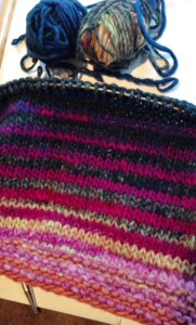 Here is the sleeve in progress.  I wound the ball I am using from each end, and am alternating balls every 2 rows.  There is more contrast than you might expect, but with Noro Kureyon, you never know what you will get.  Every single skein will be different, even in the same dye lot!