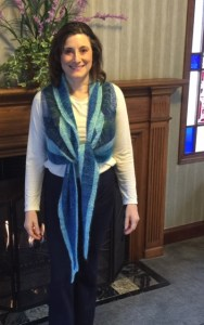 "Worn tied in the front, with the thin blue edge at the top (the shawl can be worn ""upside down"")"