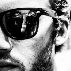 Adam Hawkins wearing raybans with his own reflection in the lens