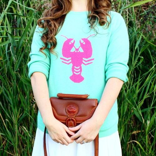 Two Bees Cashmere Lobster Motif Sweater Curly Hair Fall Outfit OOTD Worn by Annie Fairfax Dooney and Bourke Bag