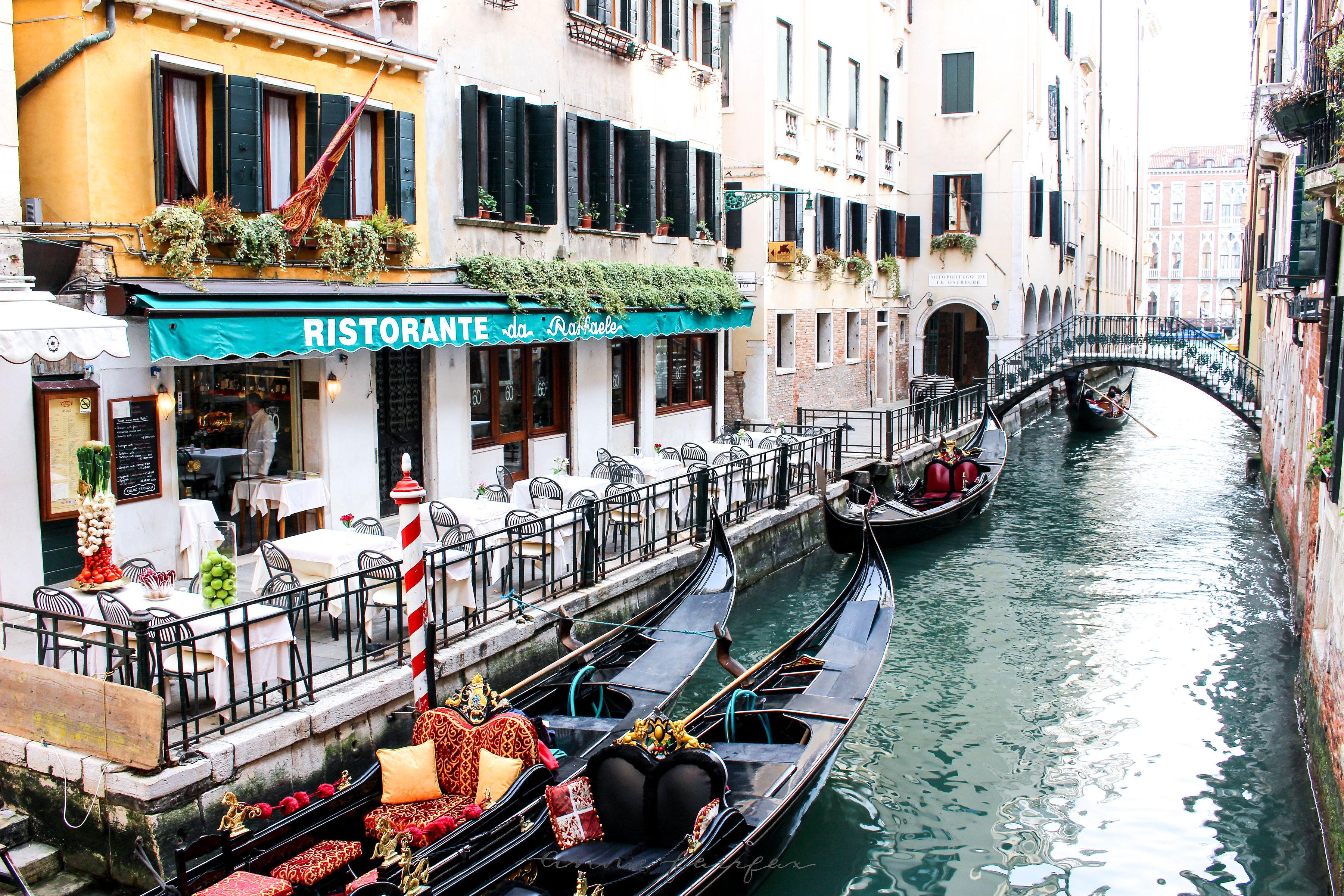Gondolas along the Canal in Venice, Italy by Annie Fairfax