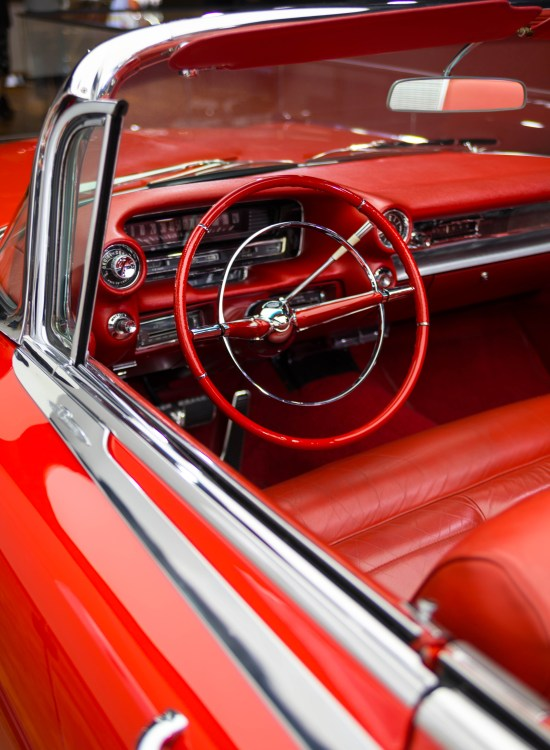 Candy Apple Red Classic Cadillac Luxury Car at Detroit's North American International Auto Show Press Preview Day NAIAS 2019 by Annie Fairfax