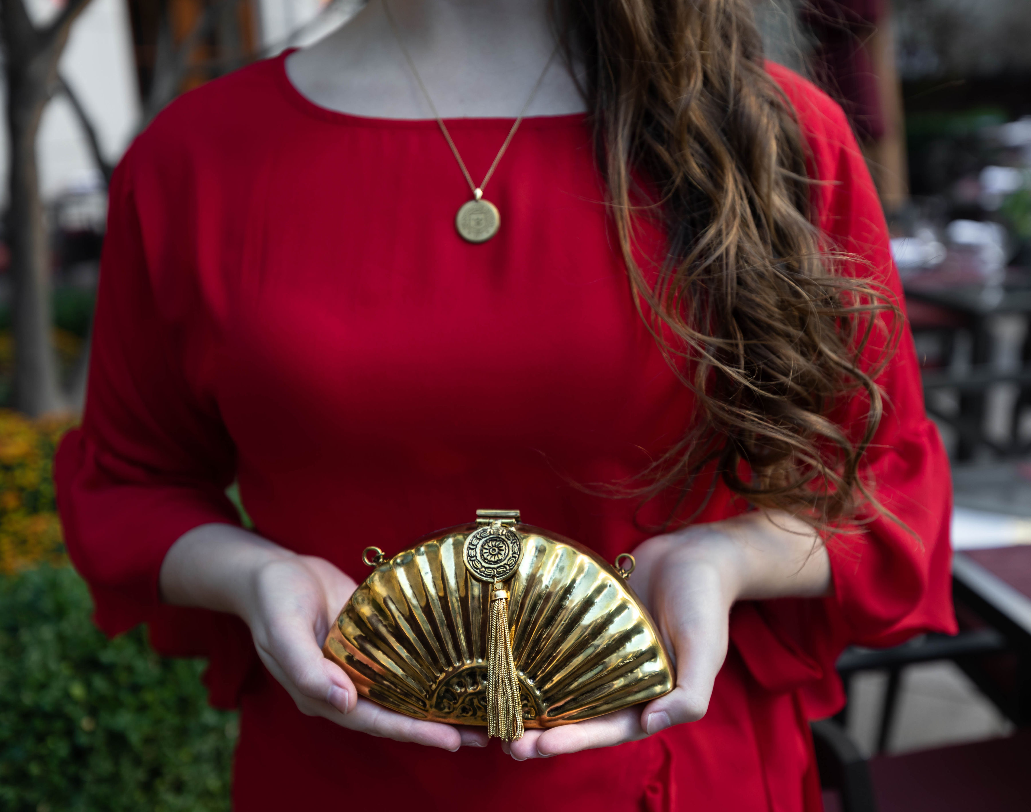 Red Dress and Golden Metal Fan Handbag by From St. Xavier at the Peninsula Hotel Chicago Midwest Travel Ideas Outfit Ideas