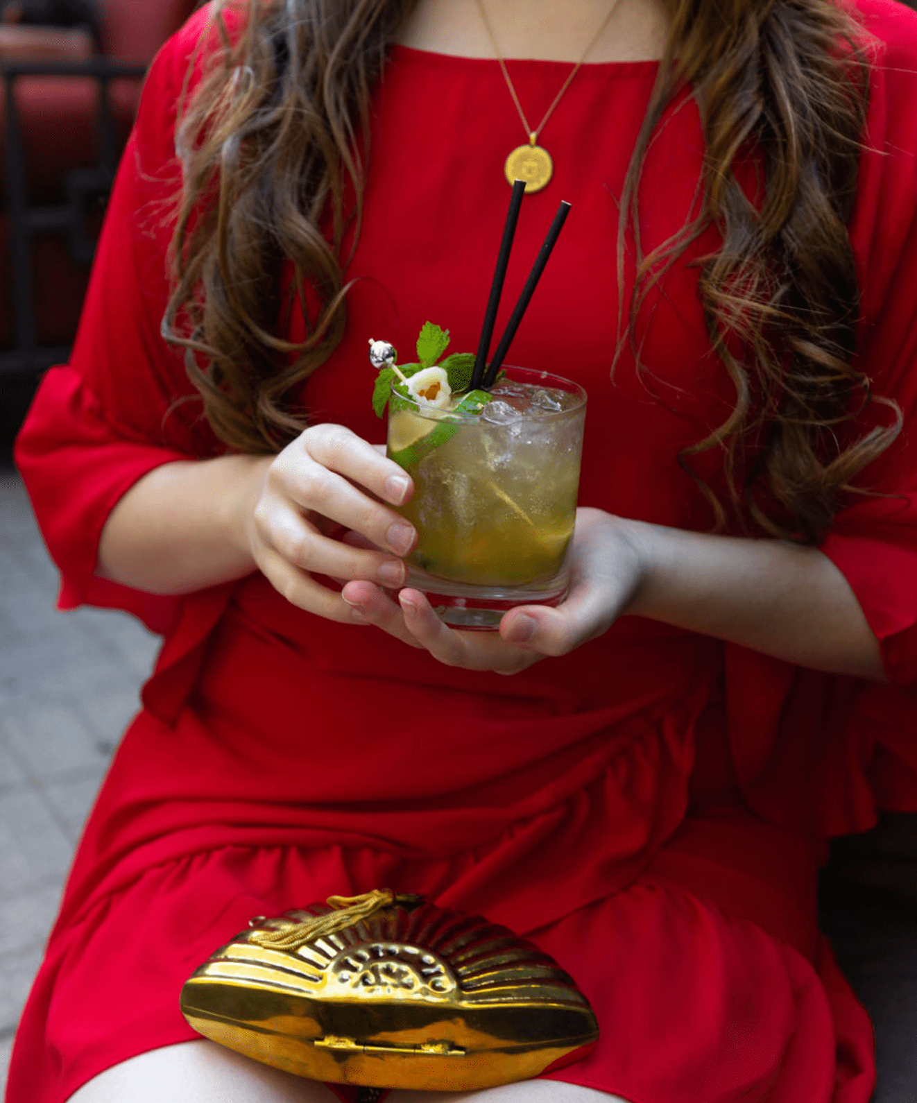 Red Dress and Golden Metal Fan Handbag by From St. Xavier at the Peninsula Hotel Chicago Midwest Travel Ideas Outfit Ideas Lychee Drink Shanghai Terrace Cantonese Delicacies Best Chinese Food in Chicago Award Winning Rooftop Dining Luxury Restaurants Midwest