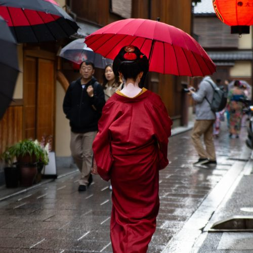 Kyoto the Official Travel Guide Gion Geisha in Red Kimono with Parasol Maiko Written and Photographed by Annie Fairfax