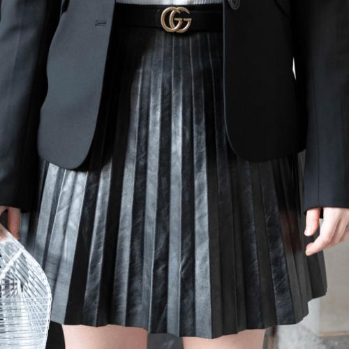 Ralph Laure Leather Pleated Skirt Gucci Belt The Limited Blazer Cult Gaia Basket Bag Birdies Sandals Curly Hair with a Handmade Black Velvet Hair Bow Worn by Annie Fairfax