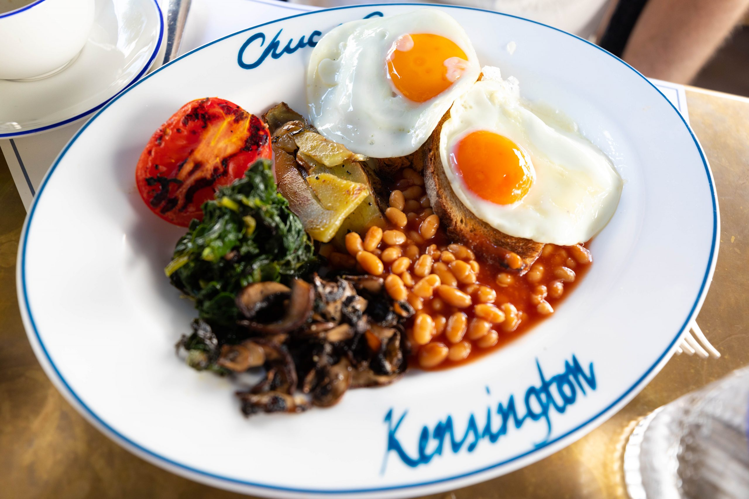 Full English Breakfast Chuc's Café in Kensington London England United Kingdom Luxury Cafés Slim Aaron Italian Yacht Mediterranean Inspired Restaurant by Annie Fairfax