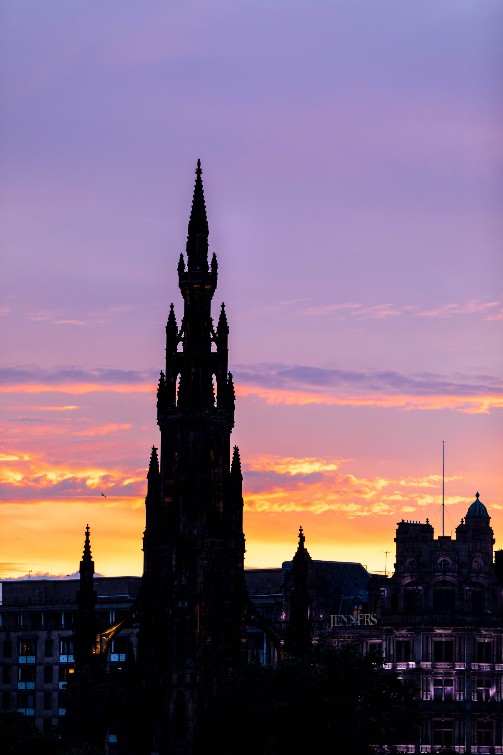 Scott Monument in Edinburgh Scotland at Sunset Luxury Travel Guide by Annie Fairfax