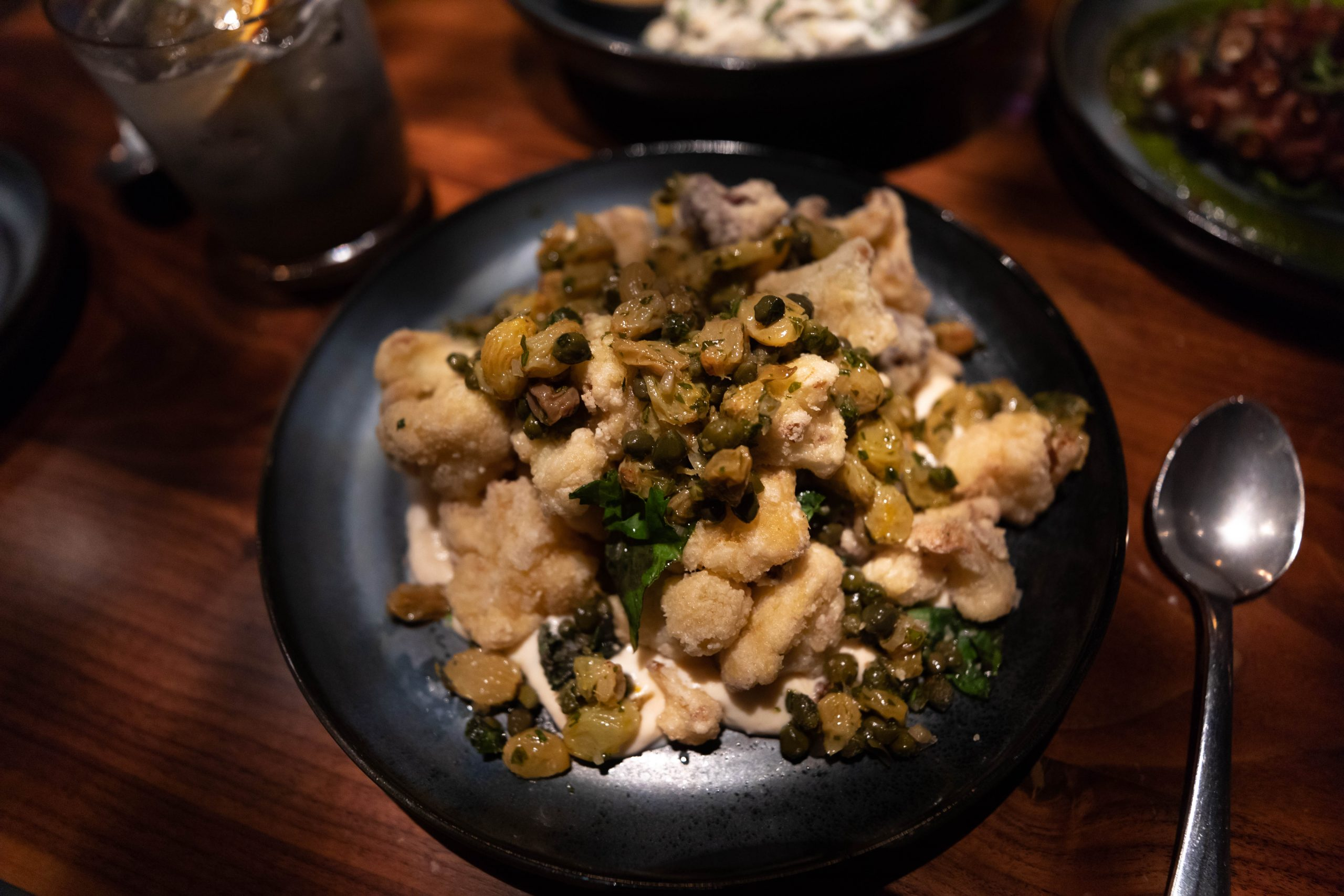 Crispy Cauliflower Golden Raisin-Caper Salsa Verde, Fresh Herbs, Red Curry Yogurt at Aerlume Seattle Washington Puget Sound Pacific Northwest Farm to Table Fine Dining by Annie Fairfax