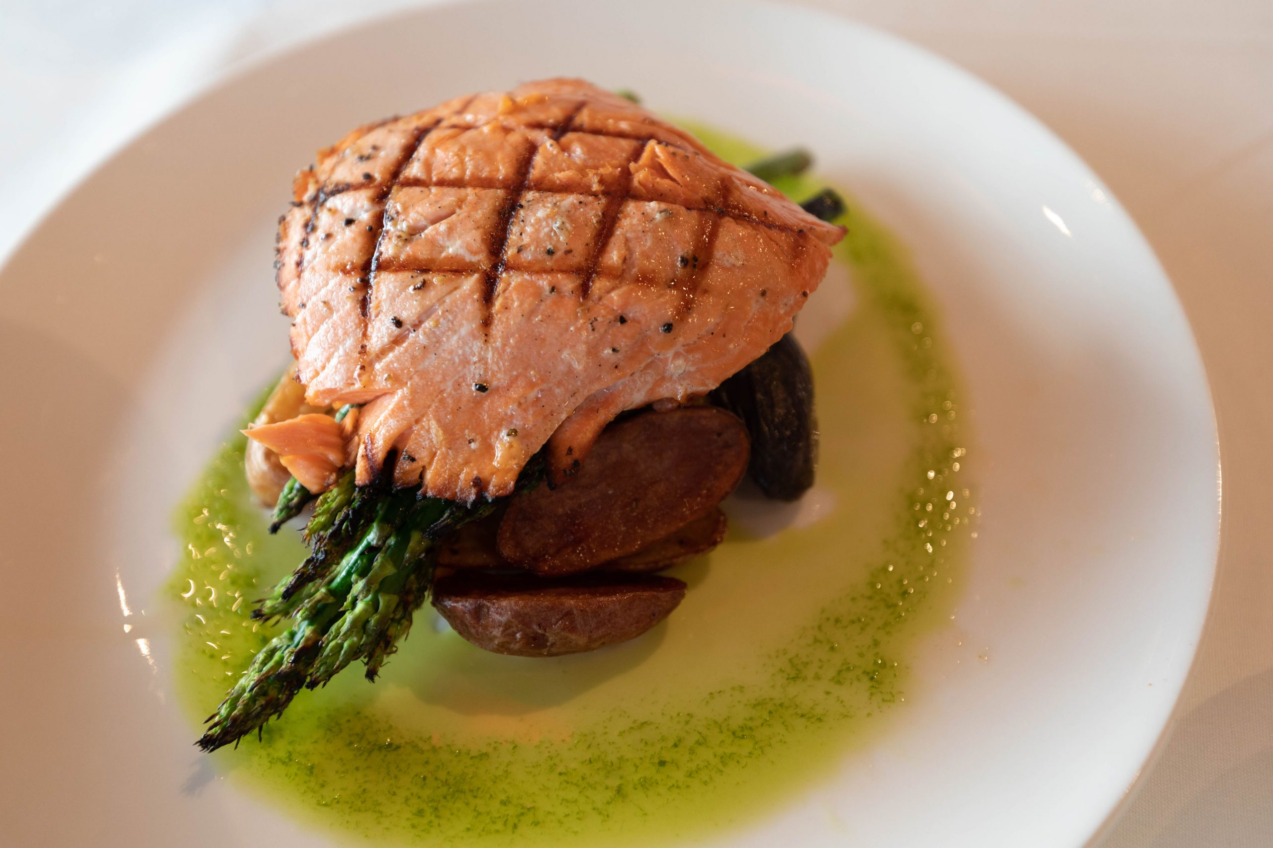 Cutter's Crab House Chef's Seasonal Salmon Dish with Aspargus, Fingerling Potatoes, Grilled, by Annie Fairfax