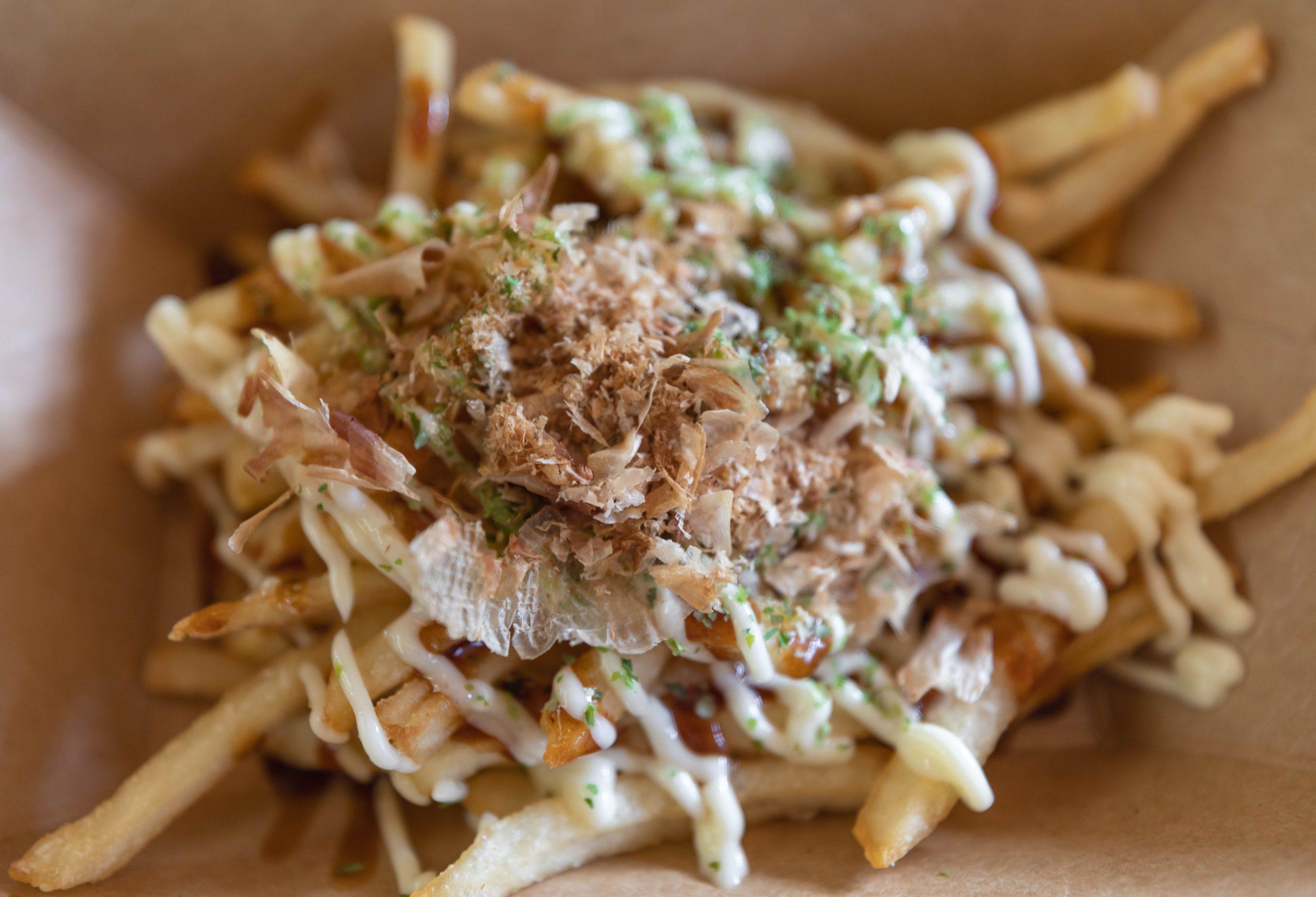 Japan Okoniyaki Fries Best Things to Eat in Epcot Walt Disney World by Luxury Travel Writer & Photographer Annie Fairfax