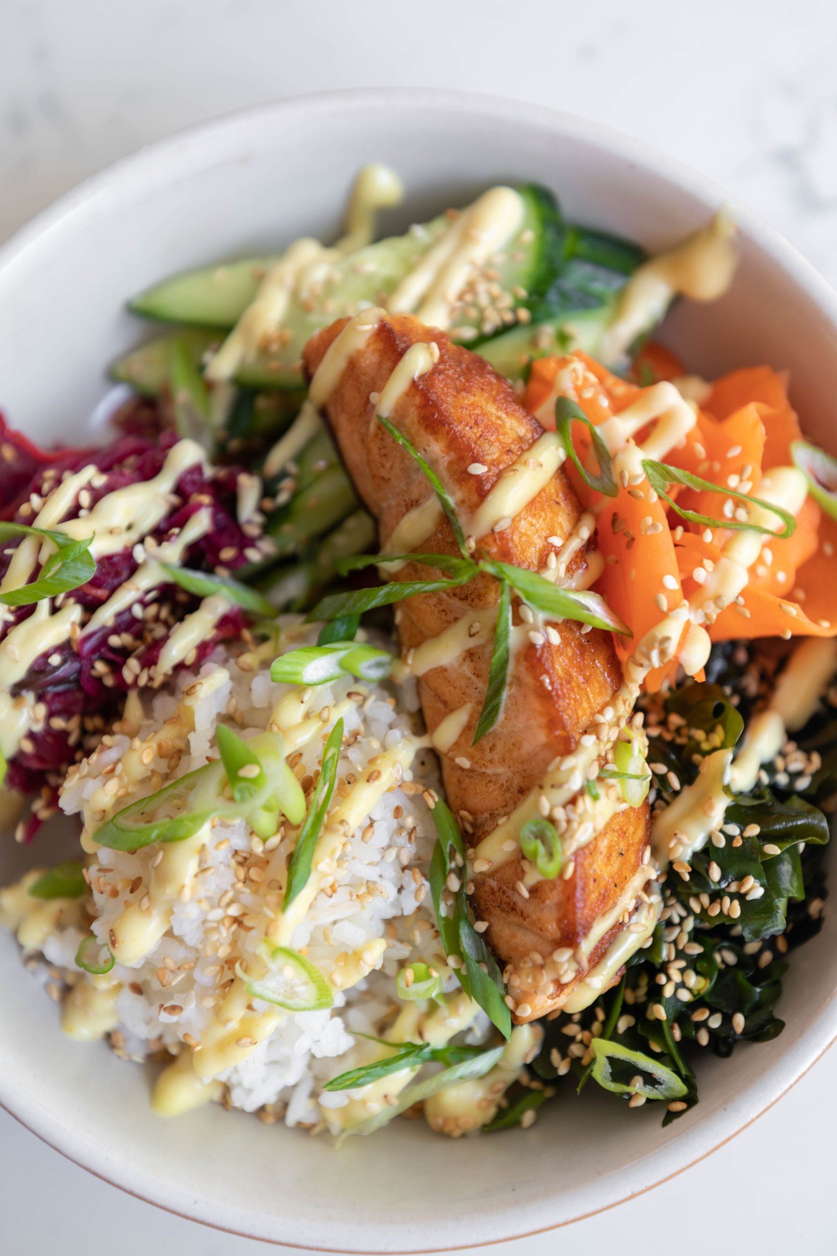 Salmon Bowl with Charleston Golden Rice at Basic Kitchen in Charleston South Carolina Plant Based Seasonal Local Cuisine Photographed by Annie Fairfax