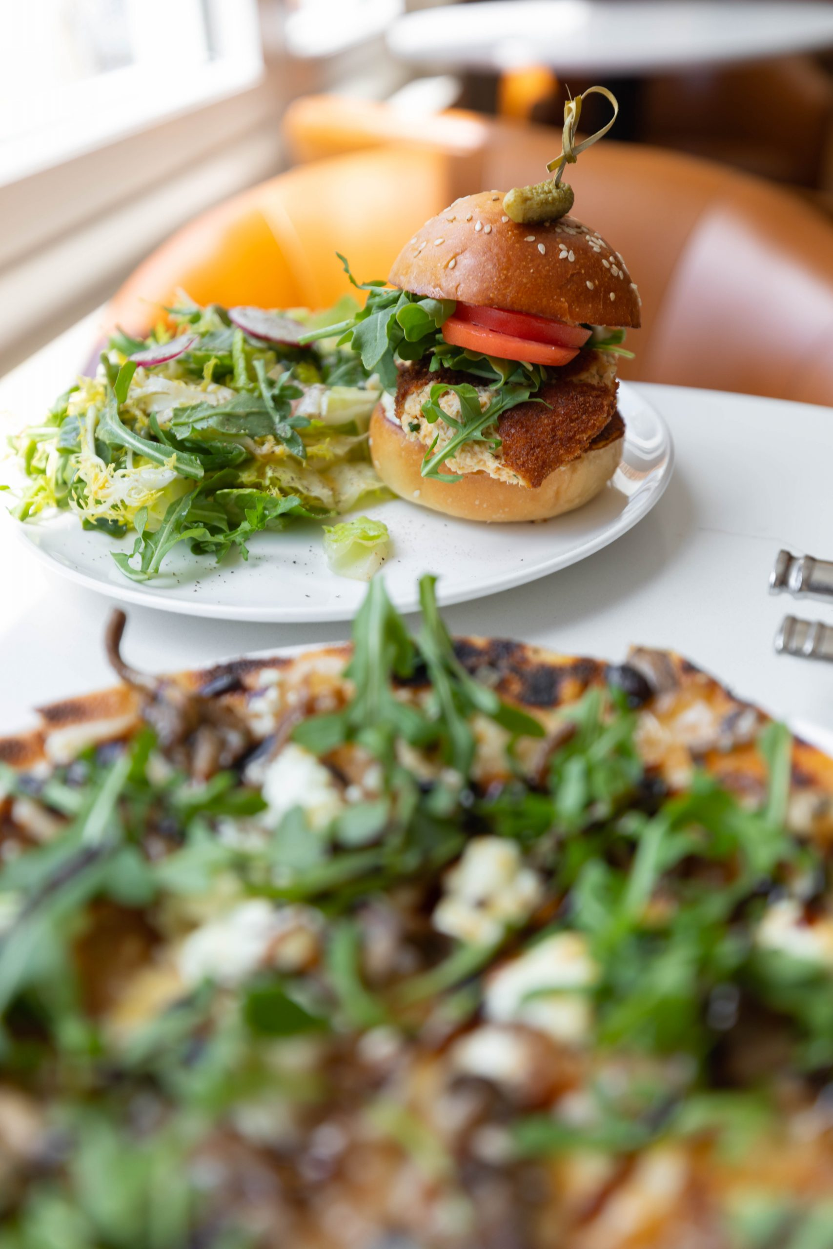 Burger and Pizza at Félix Cocktails et Cuisine in Charleston South Carolina Fine Dining French Café Photographed and Written by Luxury Travel Writer Annie Fairfax