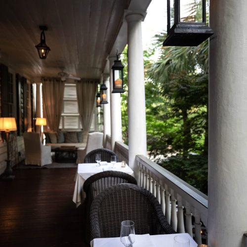 Porch of Zero George Restaurant + Bar in Charleston South Carolina Photographed and Written by Luxury Travel Writer Annie Fairfax