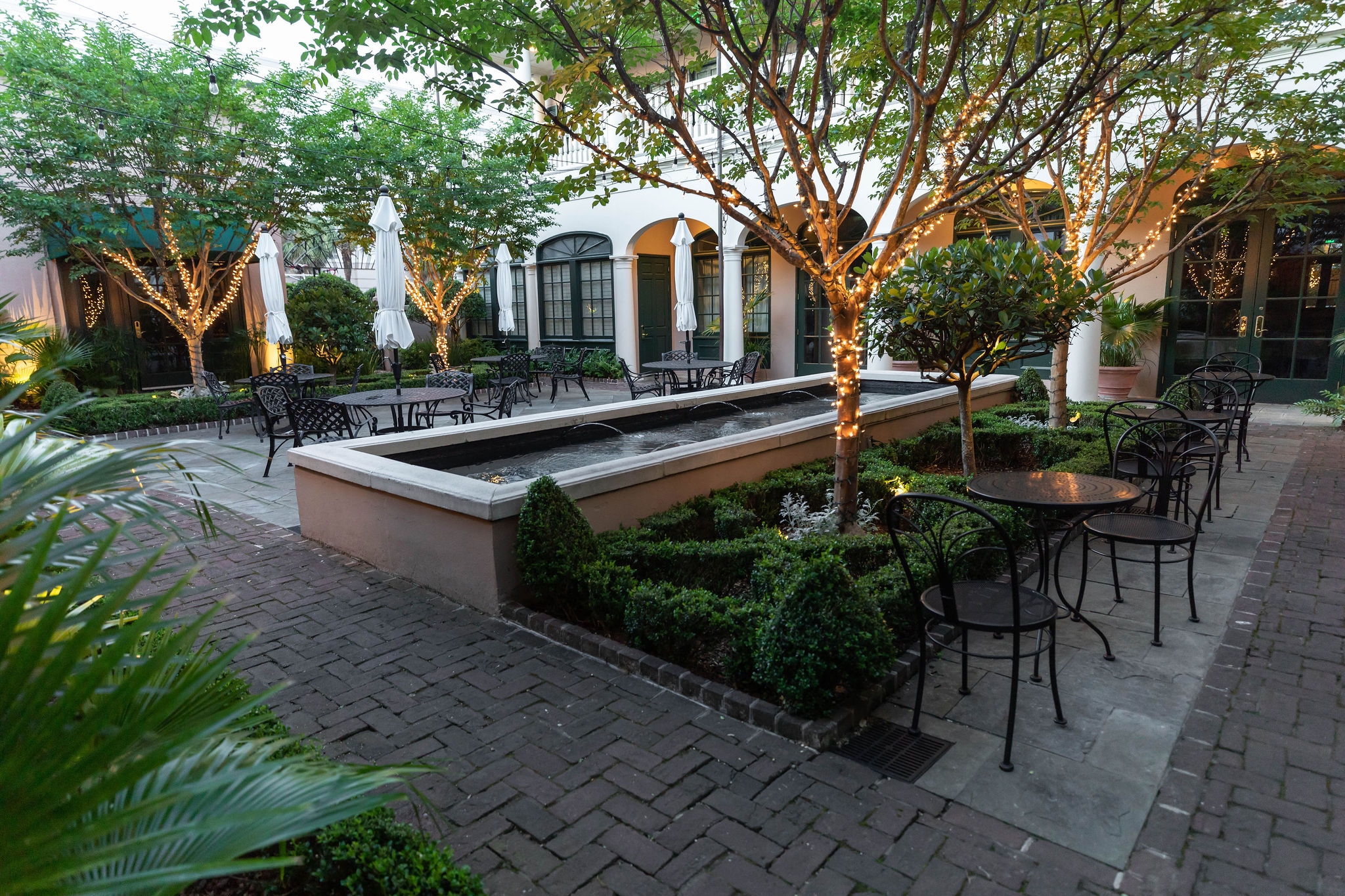 Courtyard of Planter's Inn Peninsula Grill by Relais and Château in Charleston South Carolina by Annie Fairfax Fine Dining Luxury Restaurants of the World