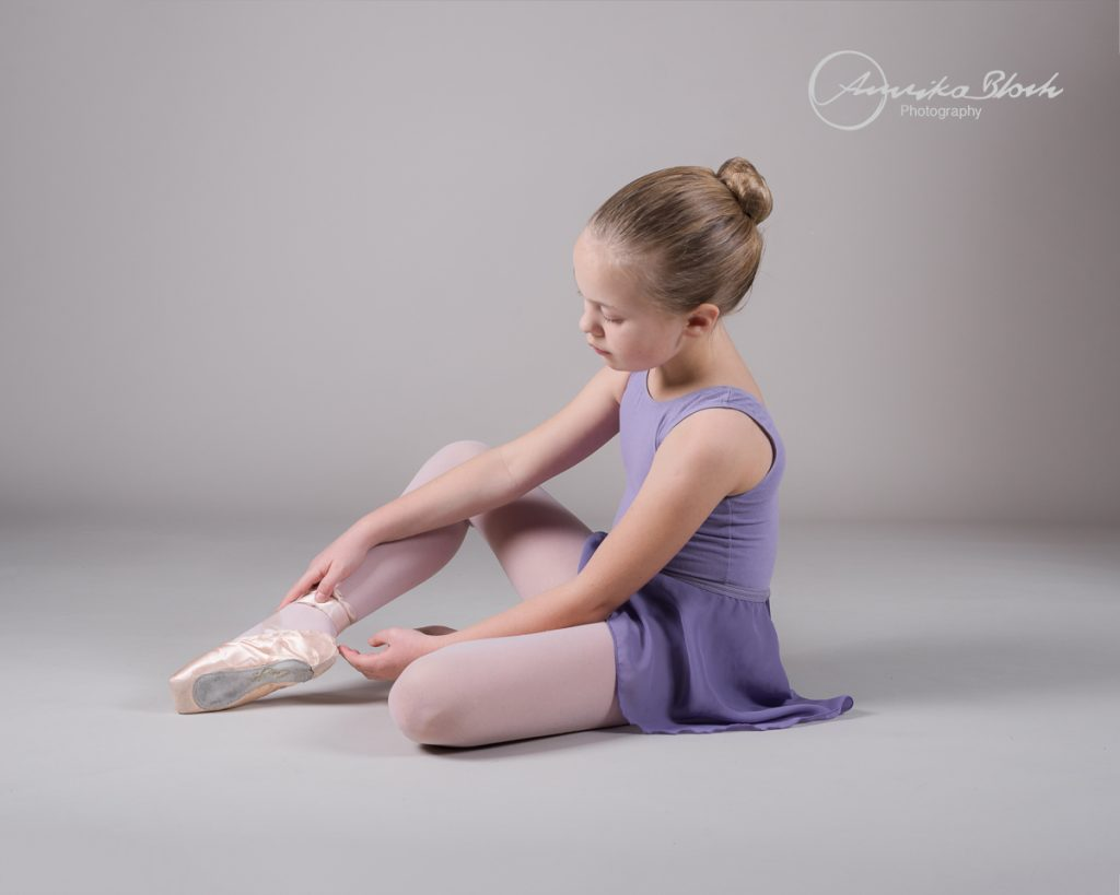 A young girl getting ready for her ballet photography session in West London, Dance photography in Maida Vale