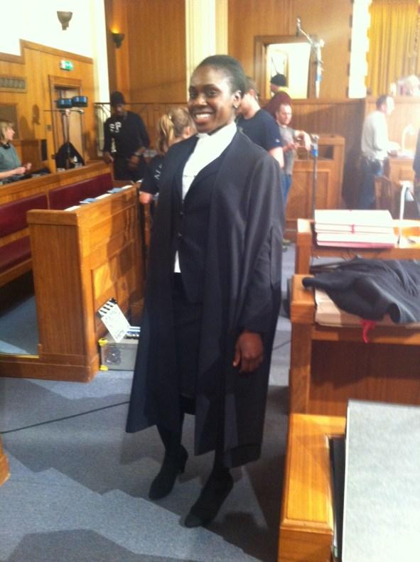 Anniwaa Buachie as Clerk Lewis (Behind the scenes)