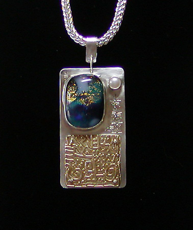 Etched brass, sterling, glass, and pearl pendant