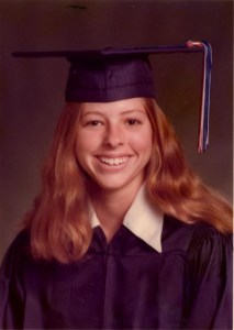 "My graduation portrait--in a ""boy"" gown because I liked blue better."
